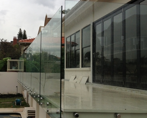 Button fix frameless glass balustrade