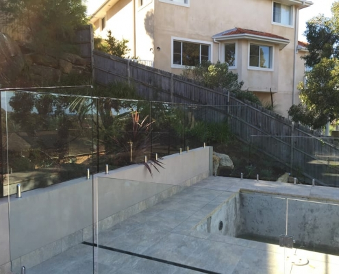Frameless glass fence on hill Cromer Heights