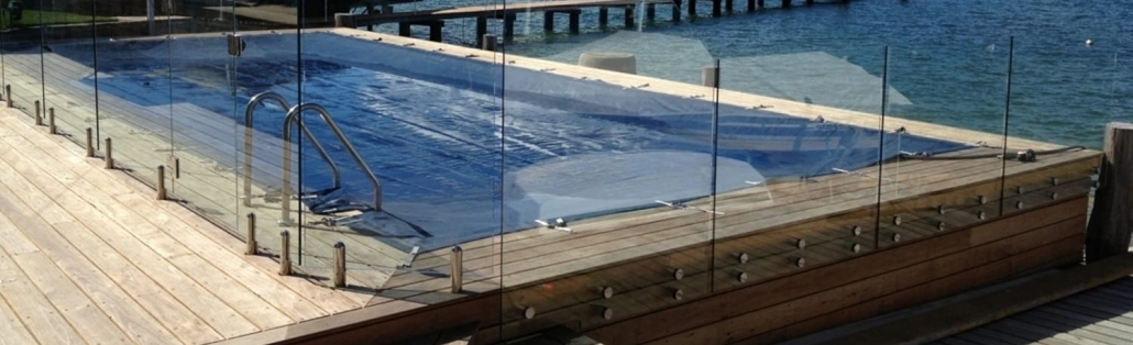 Fully frameless glass pool fence button fix at Avalon water front