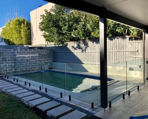 black spigot with glass pool fencing