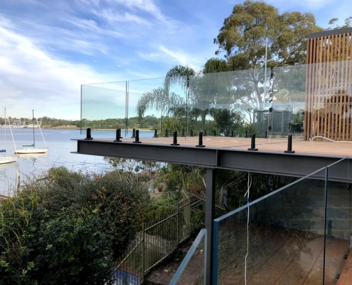 full frameless glass on timber decking with black spigots