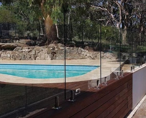timber mount and core drilled glass and aluminium pool fence
